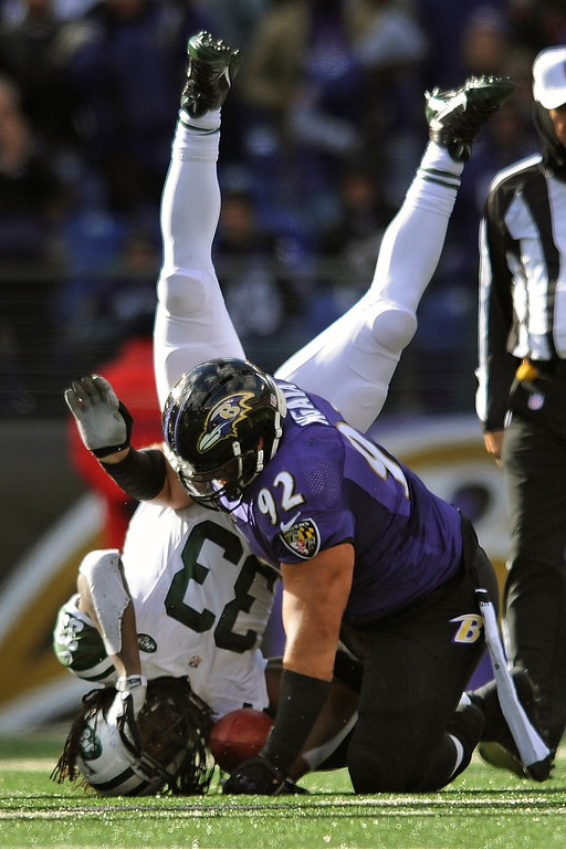 . New York Jets running back Chris Ivory is upended by Baltimore Ravens\' Haloti Ngata during the first half of an NFL football game in Baltimore, Md., Sunday, Nov. 24, 2013. (AP Photo/Gail Burton)