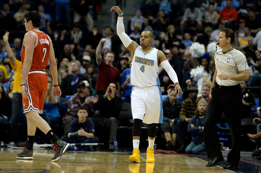 . DENVER, CO - MARCH 03: Randy Foye (4) of the Denver Nuggets holds his pose after hitting a late three-pointer as Ersan Ilyasova (7) of the Milwaukee Bucks walks to the bench during the second half of a 106-95 Nuggets win. The Denver Nuggets hosted the Milwaukee Bucks at the Pepsi Center on Tuesday, March 3, 2015. (Photo by AAron Ontiveroz/The Denver Post)