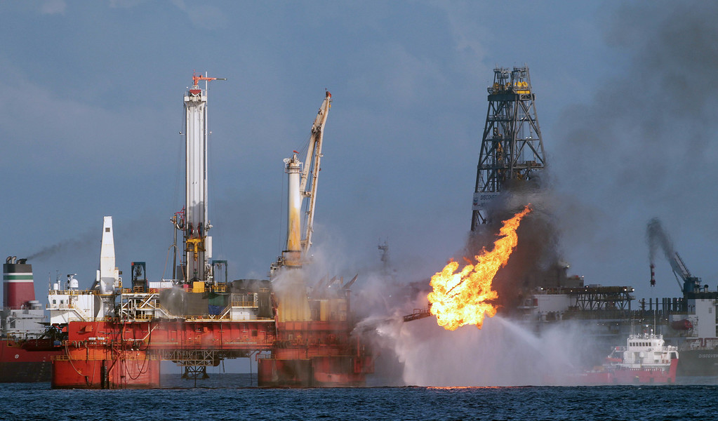 . Vessels operate in the area of the Deepwater Horizon disaster on the Gulf of Mexico, Tuesday, July 13, 2010. BP officials have placed a containment cap over the leak in hopes that the flow of oil will be diminished. (AP Photo/Dave Martin)