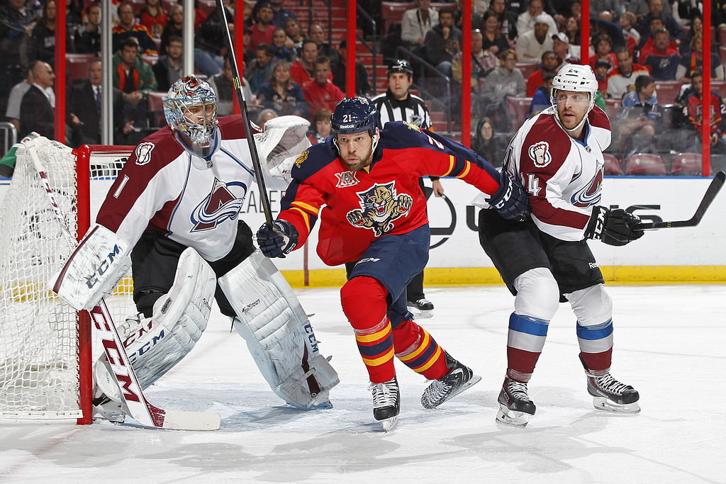 . SUNRISE, FL - JANUARY 24: Krys Barch #21 of the Florida Panthers skates through the goal crease after goaltender Semyon Varlamov #1 of the Colorado Avalanche made a save during first period action at the BB&T Center on January 24, 2014 in Sunrise, Florida. (Photo by Joel Auerbach/Getty Images)