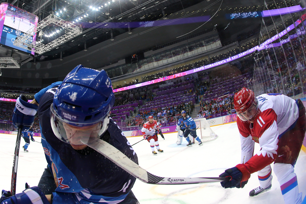 . Yevgeni Malkin #11 of Russia hits Ossi Vaananen #4 of Finland with his stick during the Men\'s Ice Hockey Quarterfinal Playoff on Day 12 of the 2014 Sochi Winter Olympics at Bolshoy Ice Dome on February 19, 2014 in Sochi, Russia.  (Photo by Martin Rose/Getty Images)