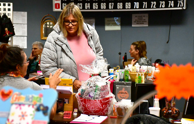 10/27/2018 Mike Orazzi | Staff Nikki Adams looks over crafts for sale during the Bristol Senior Center's annual craft fair on Saturday in Bristol.