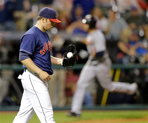 . Cleveland Indians relief pitcher Cody Allen, left, waits for Detroit Tigers\' J.D. Martinez, right, to run the bases after Martinez hit a three-run home run in the ninth inning of a baseball game, Tuesday, Sept. 2, 2014, in Cleveland. Torii Hunter and Steven Moya scored on the play. The Tigers defeated the  Indians 4-2. (AP Photo/Tony Dejak)