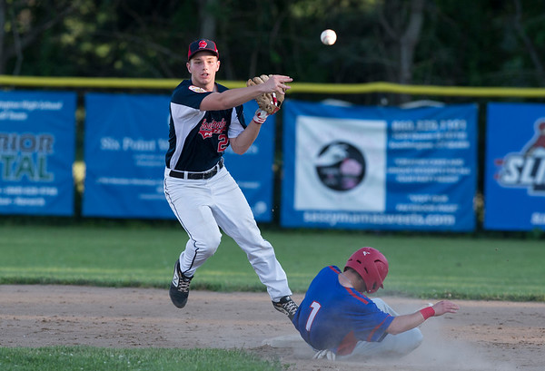06/27/19 Wesley Bunnell | Staff Berlin Post 68 Legion baseball vs Southington Post 72 on Thursday June 27, 2019. Kyle Leifert (21) turns the double play as Berlin's Mike Giove (1) slides in to second.