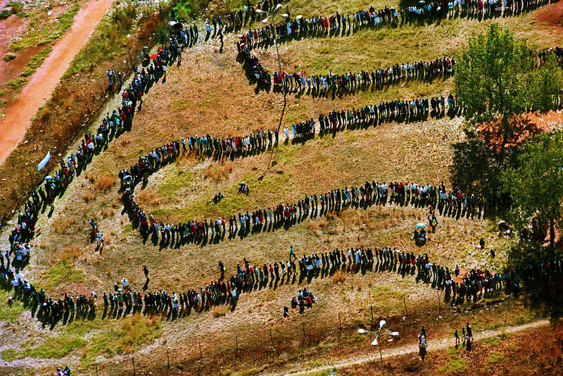 . This  April 27, 1994 aerial file  photo shows long lines of people queuing outside the polling station in the black township of Soweto, in the southwest suburbs of Johannesburg, South Africa. Against all odds, the party of Nelson Mandela which  has transformed a nation where just 20 years ago black South Africans could not vote, and beaches and restaurants were reserved for whites only, is celebrating its 100th anniversary in Bloemfontein Sunday Jan 8 2012.The majority of South Africa\'s 22 million voters were voting in the nation\'s first all-race elections. (AP Photo/Denis Farrell, File)