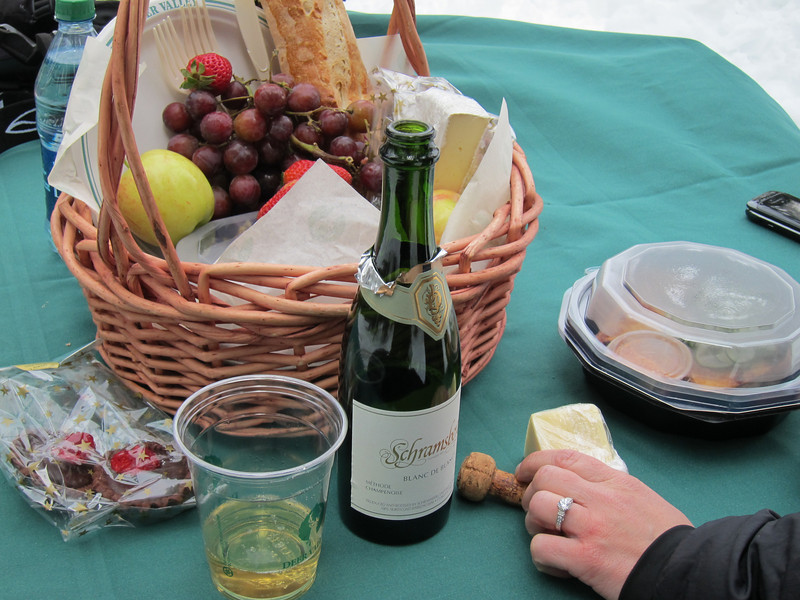 A little champagne and a great picnic basket full of treats.