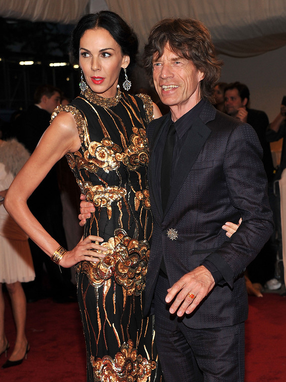 ". Designer L\'Wren Scott and musician Mick Jagger attend the ""Alexander McQueen: Savage Beauty\"" Costume Institute Gala at The Metropolitan Museum of Art on May 2, 2011 in New York City.  (Photo by Stephen Lovekin/Getty Images)"