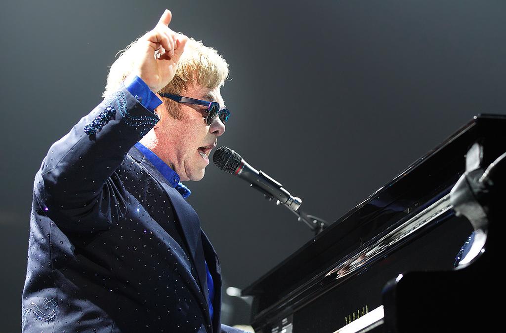 . Elton John performs at Joe Louis Arena on Friday night. Photo by Ken Settle