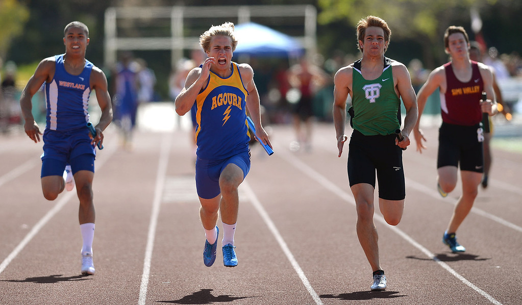 . Runners battle during the 4X100 relay during the Marmonte League track and field finals May 9, 2014 in Moorpark.(Andy Holzman/Los Angeles Daily News)