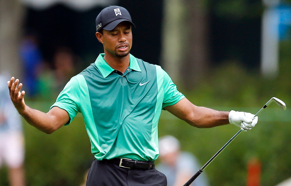 . Tiger Woods reacts after his shot from the fifth fairway landed in the gallery during the third round of the Deutsche Bank Championship golf tournament in Norton, Mass., Sunday, Sept. 1, 2013. (AP Photo/Michael Dwyer)