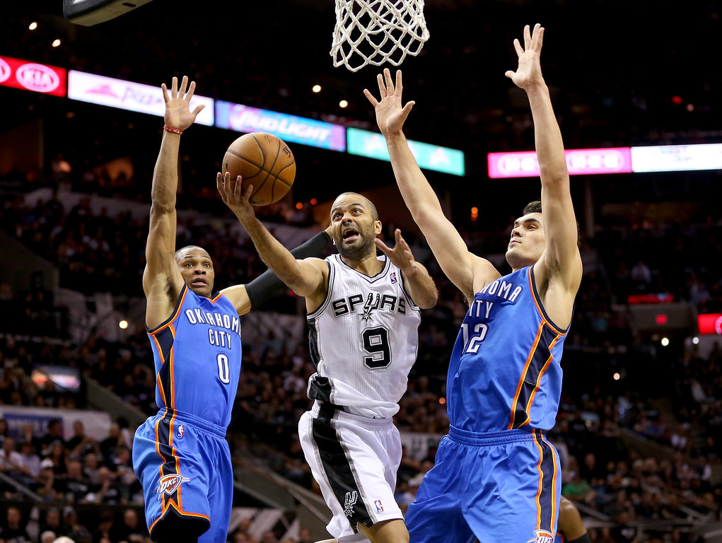 . Tony Parker #9 of the San Antonio Spurs goes up for a shot between Russell Westbrook #0 and Steven Adams #12 of the Oklahoma City Thunder in the first half in Game One of the Western Conference Finals during the 2014 NBA Playoffs at AT&T Center on May 19, 2014 in San Antonio, Texas.  (Photo by Ronald Martinez/Getty Images)