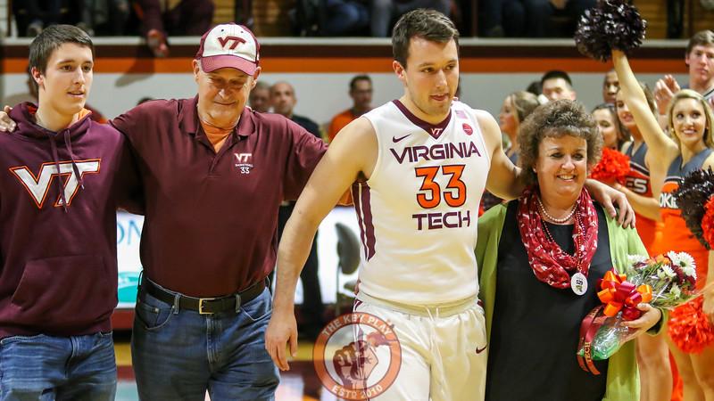 Matt Galloway walks onto the court with his family. (Mark Umansky/TheKeyPlay.com)