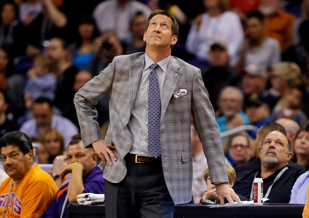 . Phoenix Suns head coach Jeff Hornacek looks at the scoreboard during the first half of an NBA basketball game against the Los Angeles Clippers, Wednesday, April 2, 2014, in Phoenix. (AP Photo/Matt York)