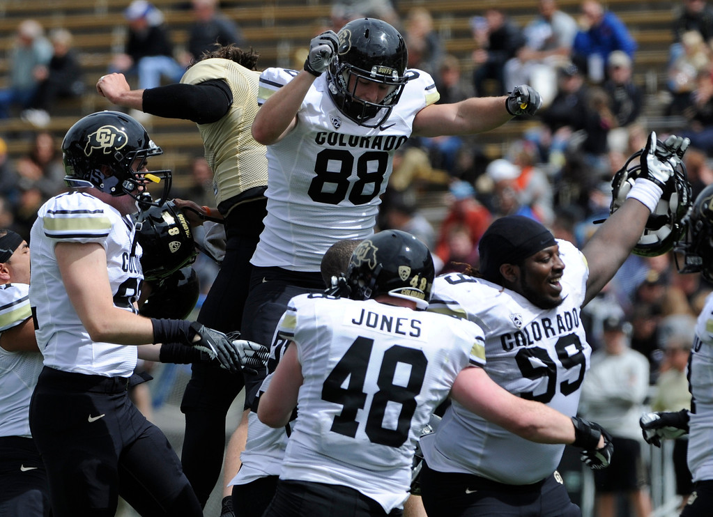 . BOULDER, CO.- APRIL13: The White team celebrates its win. The University of Colorado football team hosts its spring football game at Folsom Field under the direction of new head coach Mike Macintyre. (Photo By Kathryn Scott Osler/The Denver Post)