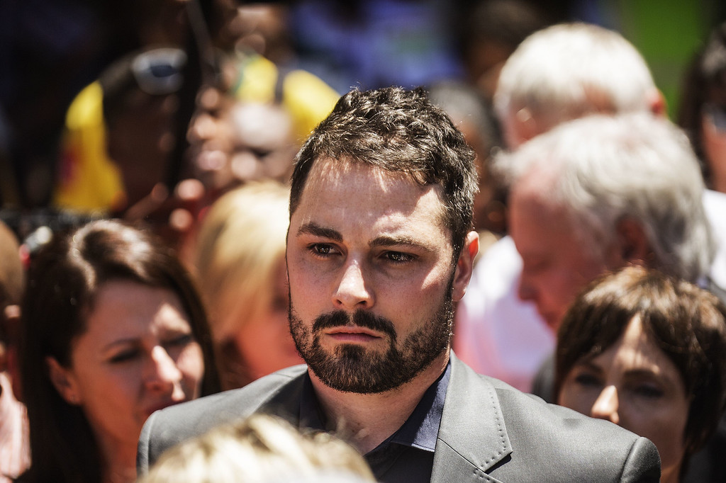 . Carl Pistorius, the brother of paralympian star Oscar Pistorius, leaves the High Court following his brother\'s sentencing in Pretoria, on October 21, 2014. AFP PHOTO/GIANLUIGI GUERCIA/AFP/Getty Images