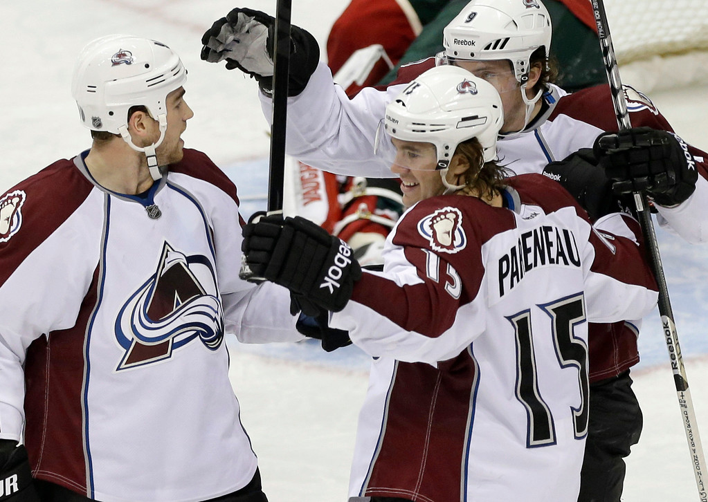 . Colorado Avalanche\'s Ryan O\'Reilly, left, joins in the celebration after P.A. Parenteau (15) scored his second goal of the night off Minnesota Wild goalie Niklas Backstrom, during the third period of an NHL hockey game Thursday, March 14, 2013, in St. Paul, Minn. The Wild won 5-3. (AP Photo/Jim Mone)
