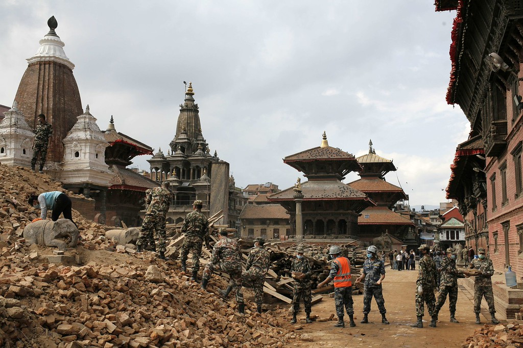 . In this hand out photograph taken and released by Caritas Internationalis on April 29, 2015, Nepalese police and army personnel clear rubble of temples at Durbar square, the UNESCO world heritage site damaged by the earthquake in Kathmandu.   A total of 5,057 people are so far known to have died in Nepal and around 100 more in neighboring India and China following the 7.8 magnitude earthquake on April 25. Around 8,000 were injured while the United Nations estimates that eight million people have been affected.  AFP PHOTO/ MATTHIEU ALEXANDRE/CARITAS INTERNATIONALIS/AFP/Getty Images