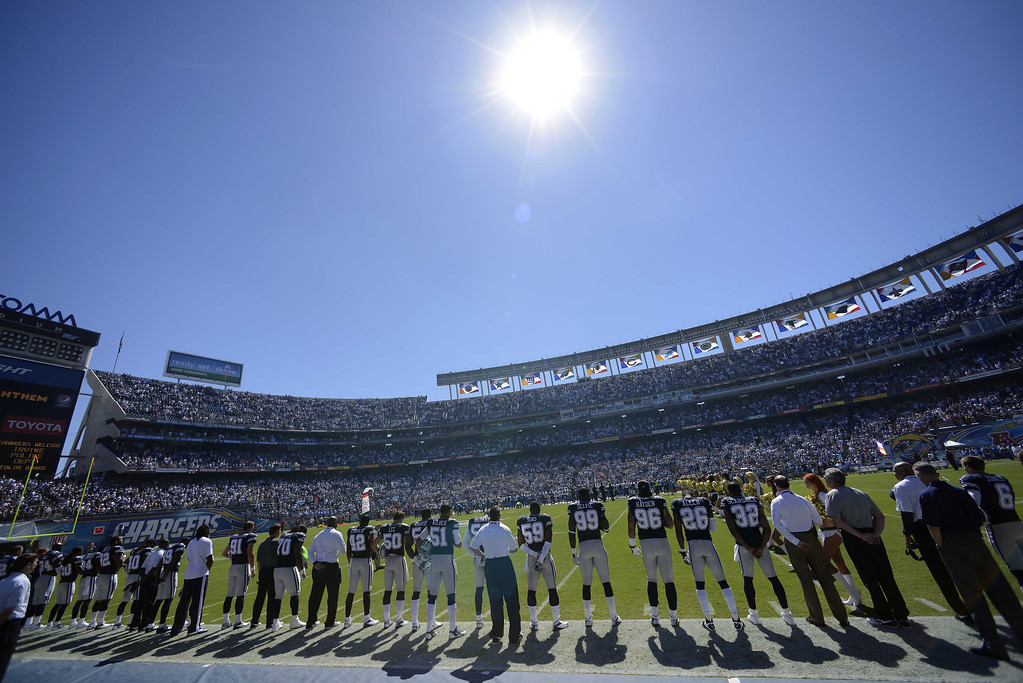 . SAN DIEGO, CA - SEPTEMBER 29:  The Dallas Cowboys listen to the National Anthem before the game against the San Diego Chargers on September 29, 2013 at Qualcomm Stadium in San Diego, California. (Photo by Donald Miralle/Getty Images)