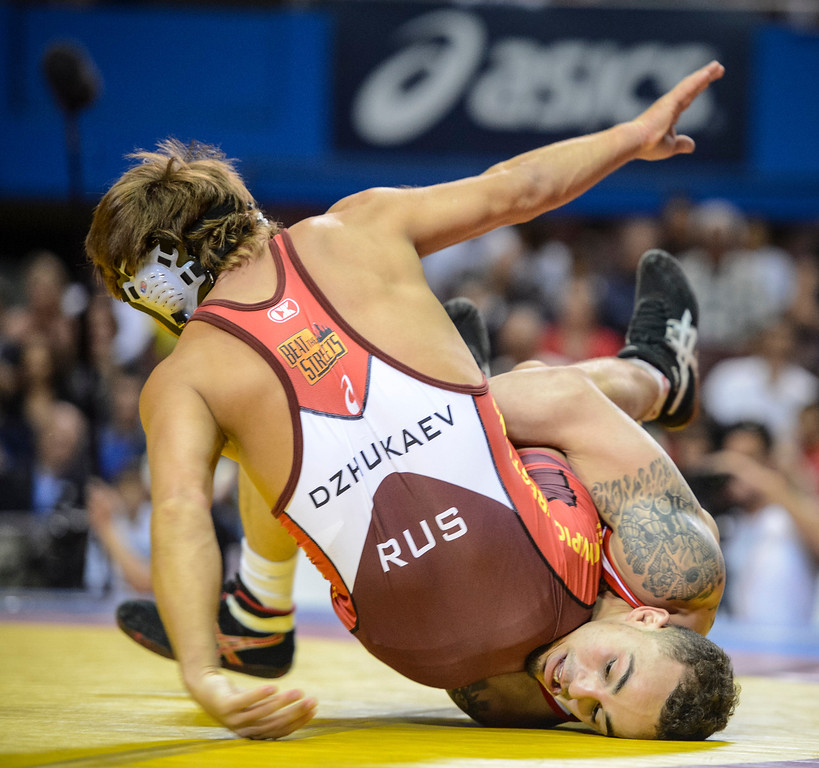 . Russian Rasul Dzhukaev and the US\'s Jordan Oliver, bottom during their match at the USA vs Russia vs Canada dual meet at the Sports Arena Sunday .  Photo by David Crane/Los Angeles Daily News.