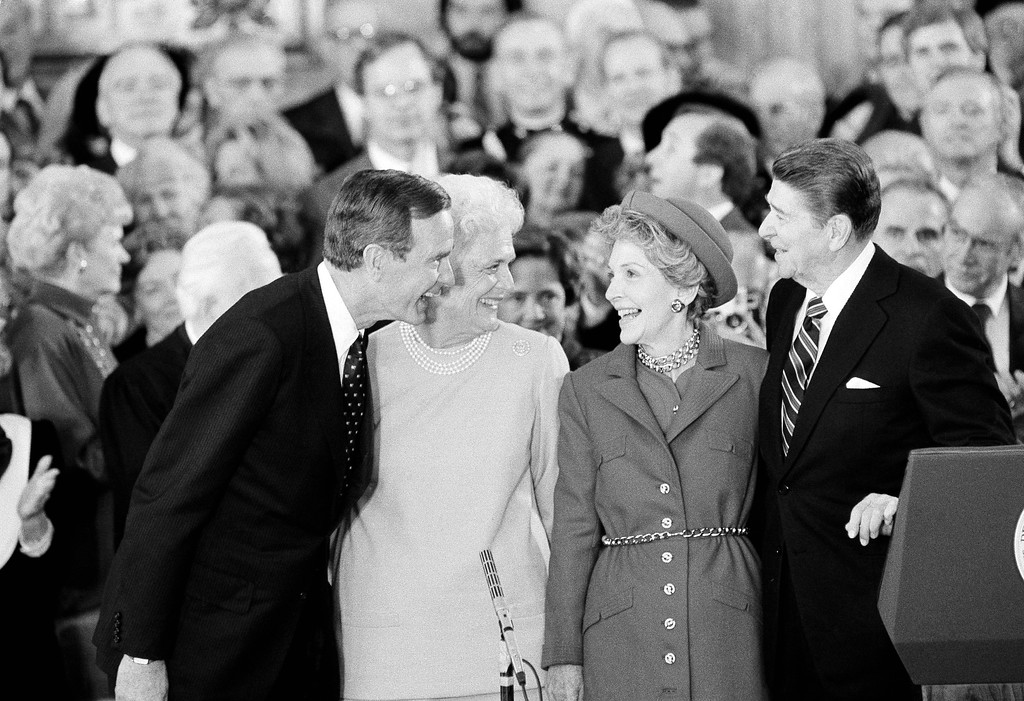 . President and Mrs. Ronald Reagan, right, share a moment with Vice President and Mrs. George Bush following the oaths in the Capitol Building in Washington on Monday, Jan. 21, 1985. (AP Photo/Bob Daugherty)