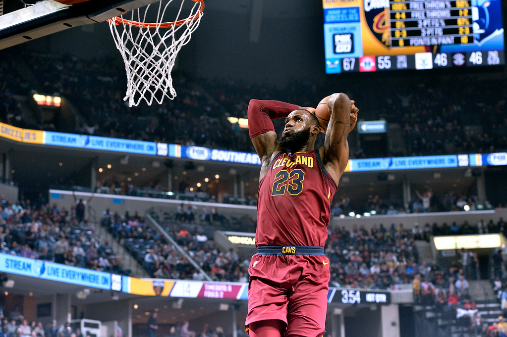 . Cleveland Cavaliers forward LeBron James goes up for a dunk during the first half of an NBA basketball game against the Memphis Grizzlies on Friday, Feb. 23, 2018, in Memphis, Tenn. (AP Photo/Brandon Dill)