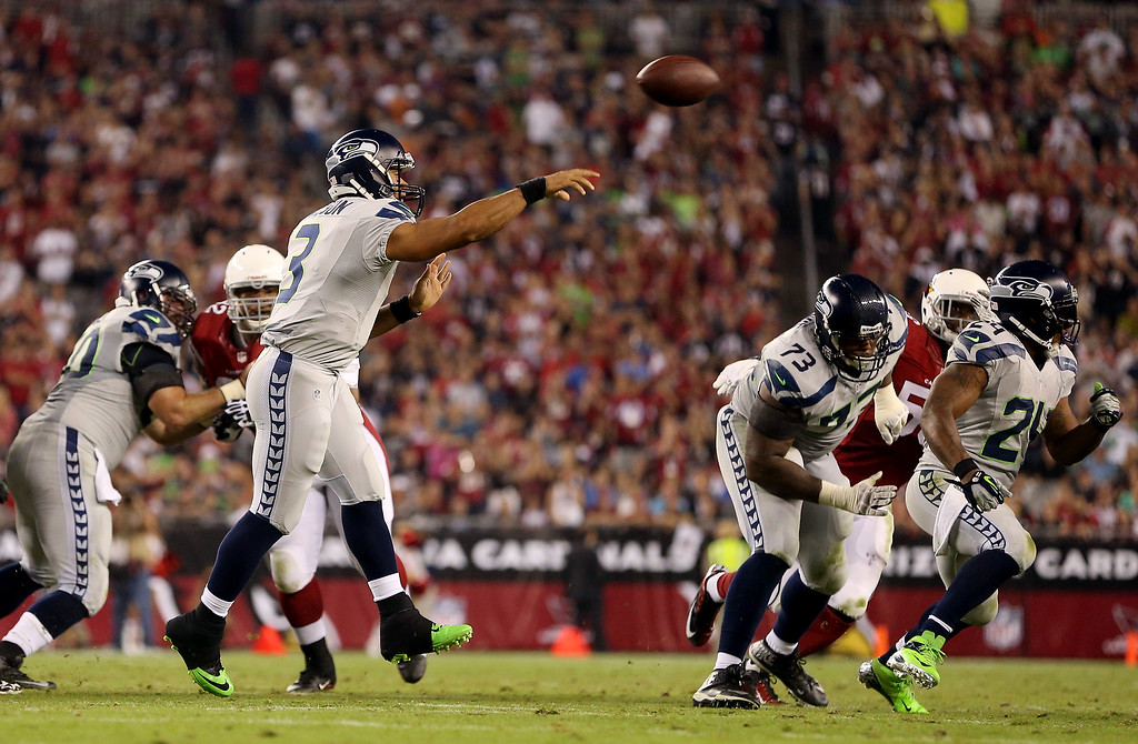 . GLENDALE, AZ - OCTOBER 17:  Quarterback Russell Wilson #3 of the Seattle Seahawks passes against the Arizona Cardinals during a game at the University of Phoenix Stadium on October 17, 2013 in Glendale, Arizona.  (Photo by Christian Petersen/Getty Images)