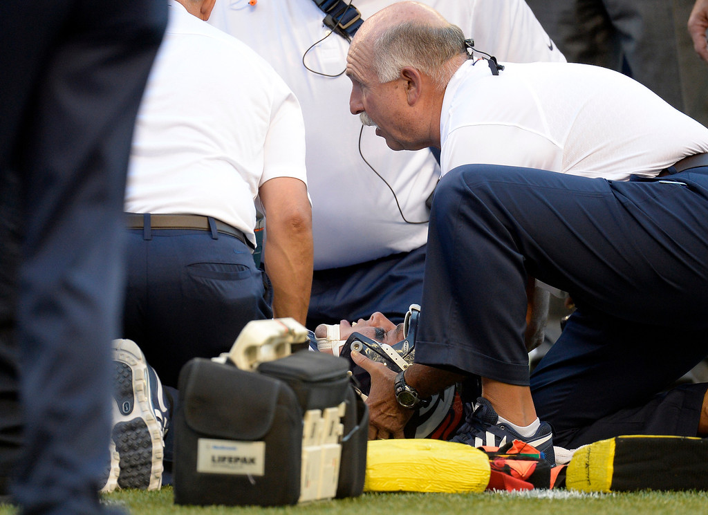 . SEATTLE, WA. - AUGUST 17: Denver Broncos defensive end Derek Wolfe (95) lays on the field motionless as medical staff looks over him after suffering an injury in the first quarter against the Seattle Seahawks August 17, 2013 at Century Link Field. He was taken to a local hospital and is evaluated for a cervical spine injury and has movement in all of his extremities. (Photo By John Leyba/The Denver Post)