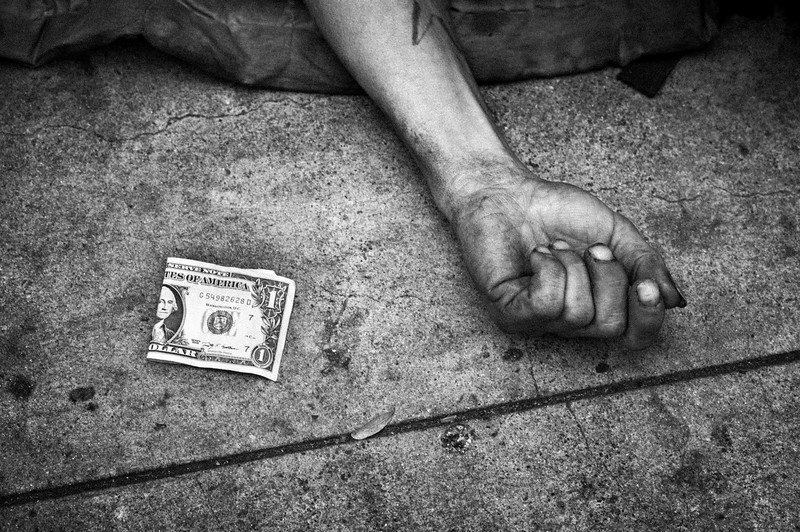 SLEEPING_HOMELESS_REACHING_OUT_FOR_DOLLAR_BILL_CLOSE_UP_SAN_FRANCISCO.jpg