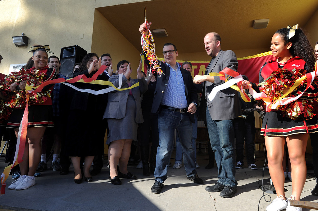 . Los Angeles City Councilman Bob Blumenfeild cuts the ribbon to open the shopping. Taft High School opened a full-scale Antiques and Collectibles Mart that occur every Saturday in the school parking lot. The school will receive a portion of the proceeds that is not funneled through and picked over by LAUSD. Los Angeles, CA. March 15, 2014 (Photo by John McCoy / Los Angeles Daily News)