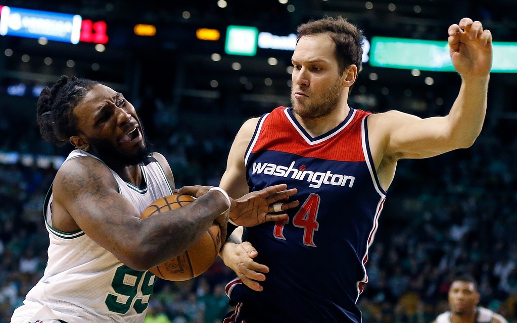 . Boston Celtics\' Jae Crowder (99) drives past Washington Wizards\' Jason Smith (14) during the second quarter of a second-round NBA playoff series basketball game, Sunday, April, 30, 2017, in Boston. (AP Photo/Michael Dwyer)