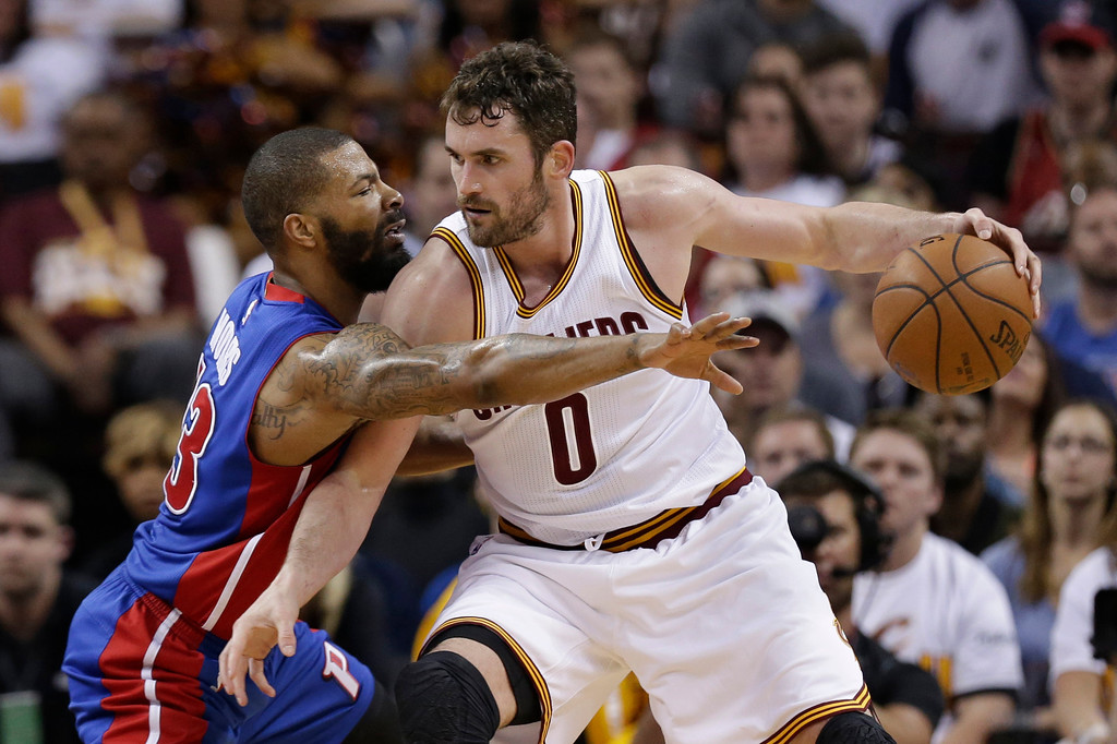. Cleveland Cavaliers\' Kevin Love, right, drives past Detroit Pistons\' Marcus Morris in the second half in Game 1 of a first-round NBA basketball playoff series, Sunday, April 17, 2016, in Cleveland. (AP Photo/Tony Dejak)