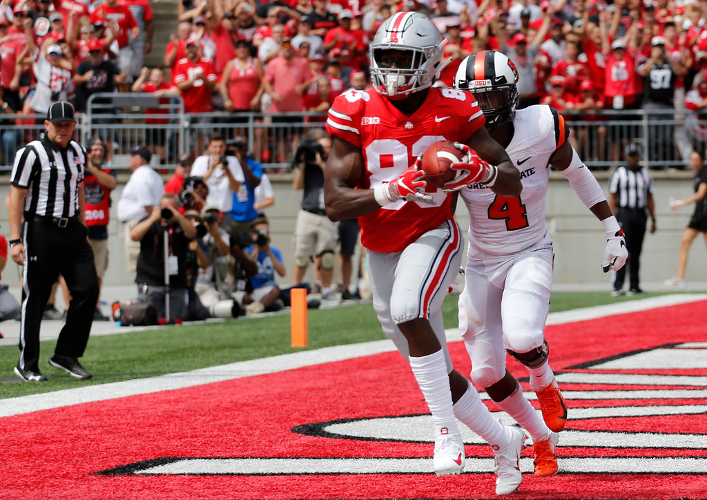 . Ohio State receiver Terry McLaurin catches a touchdown pass in front of Oregon State defensive back Dwayne Williams during the first half of an NCAA college football game Saturday, Sept. 1, 2018, in Columbus, Ohio. (AP Photo/Jay LaPrete)
