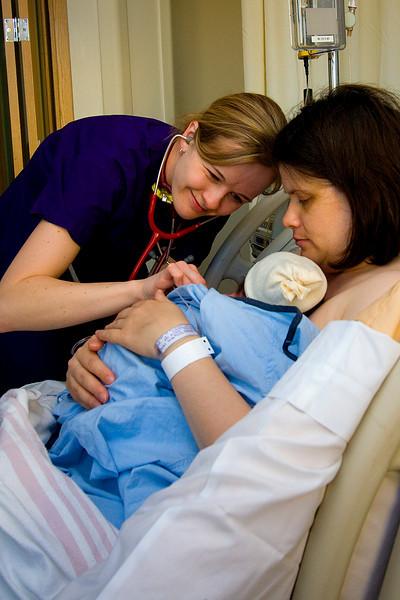 Nurse Mandy checking on Julia and Mom.