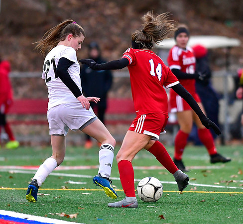11/12/2019 MIke Orazzi | StaffrJoel Barlow High School's Emily Mulhern (21) and Berlin High School's Emma Norton (14) during the Class L First Round Girls Soccer Tournament with Joel Barlow in Sage Park in Berlin.