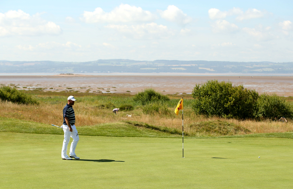 . Denmark\'s Thomas Bjorn walking on the 13th green during his first round 70, on the opening day of the 2014 British Open Golf Championship at Royal Liverpool Golf Course in Hoylake, north west England on July 17, 2014. (ANDREW YATES/AFP/Getty Images)