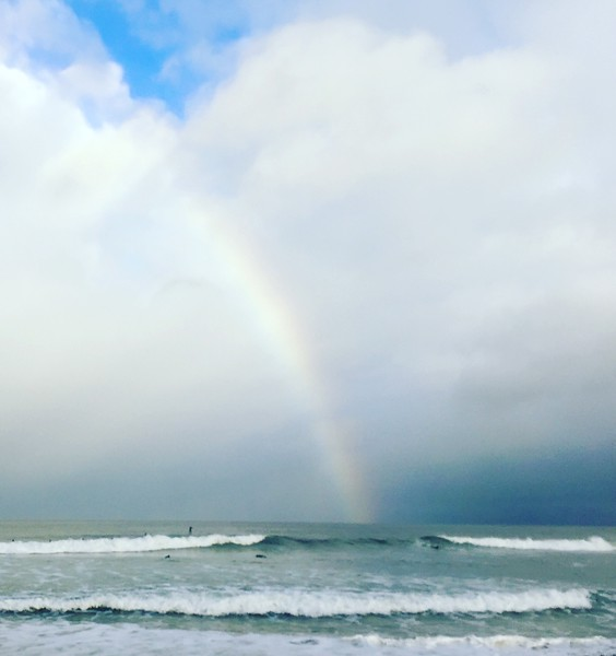Rainbow into the ocean in Northern California