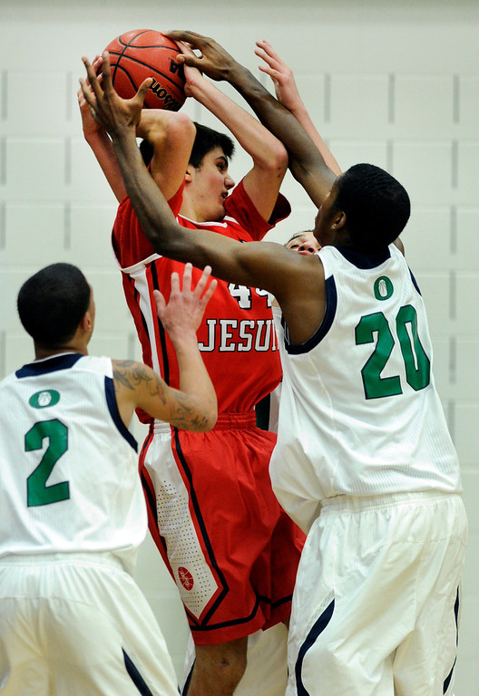 . Regis center Kip Boryla (44) was smothered by Blazers\' defenders including center De\'Ron Davi (20) in the second half. The Overland High School boy\'s basketball team defeated Regis Jesuit 80-66 Tuesday night, December 11, 2012.  Karl Gehring/The Denver Post