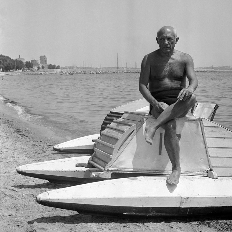 . Pablo Picasso, the 66-year-old Spanish artist who has lived most of his life in France, suns himself on a boat on the beach at Gulfe Juan on the French Riviera in France, March 10, 1948. (AP Photo)