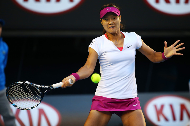 . Na Li of China plays a forehand in her women\'s final match against Dominika Cibulkova of Slovakia during day 13 of the 2014 Australian Open at Melbourne Park on January 25, 2014 in Melbourne, Australia.  (Photo by Mark Kolbe/Getty Images)