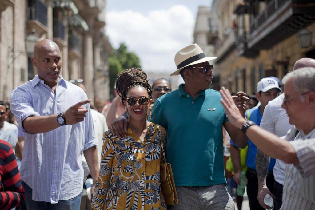 . Beyonce and Jay-Z tour Old Havana accompanied by a body guard, left, and tour guide, right. (Associated Press: Ramon Espinosa)