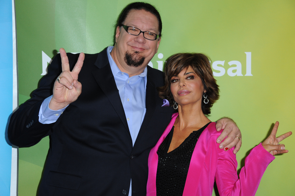 Description of . Penn Jillette, left, and Lisa Rinna attend the NBC Universal Winter TCA Tour at the Langham Huntington Hotel, Sunday, Jan. 6, 2013, in Pasadena, Calif. (Photo by Richard Shotwell/Invision/AP)