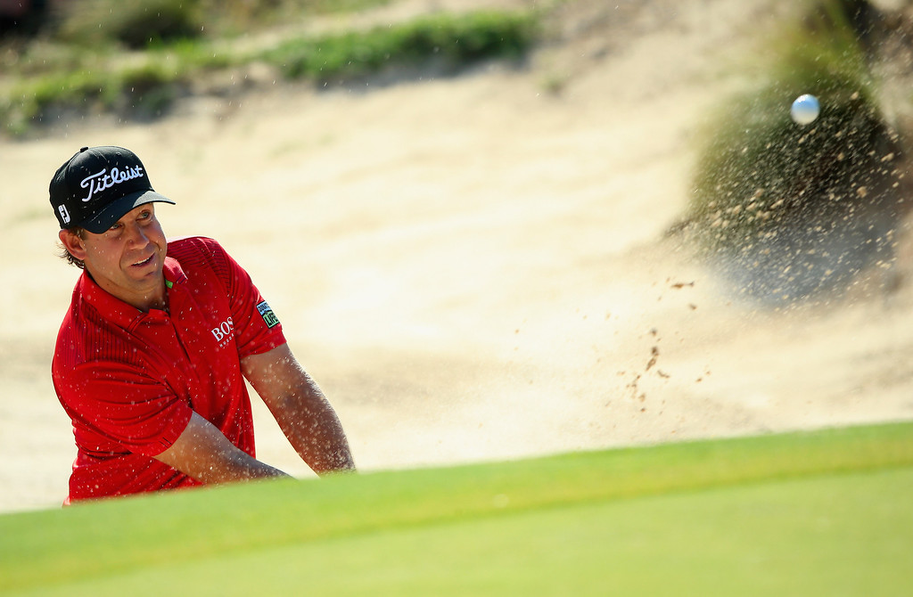 . Erik Compton of the United States hits a shot from a greenside bunker on the ninth hole during the final round of the 114th U.S. Open at Pinehurst Resort & Country Club, Course No. 2 on June 15, 2014 in Pinehurst, North Carolina.  (Photo by Andrew Redington/Getty Images)