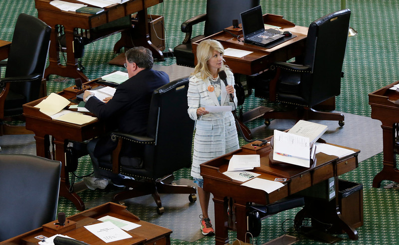 . Sen. Wendy Davis, D-Fort Worth, stands on a near empty senate floor as she filibusters in an effort to kill an abortion bill, Tuesday, June 25, 2013, in Austin, Texas. The bill would ban abortion after 20 weeks of pregnancy and force many clinics that perform the procedure to upgrade their facilities and be classified as ambulatory surgical centers.  (AP Photo/Eric Gay)