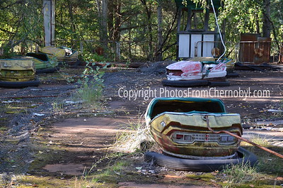 Abandoned bumper cars at Pripyat Amusement Park in Ukraine. The amusements at the park were slated to open on May Day 1986, but were unused due to the explosion at Chernobyl Nuclear Power Plant.