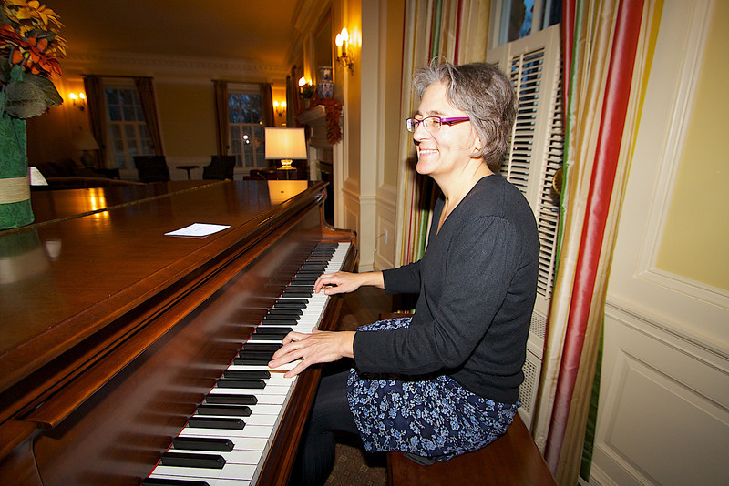 Volunteer Recognition Reception at the Macalester Alumni House. Kaia on the keybored.