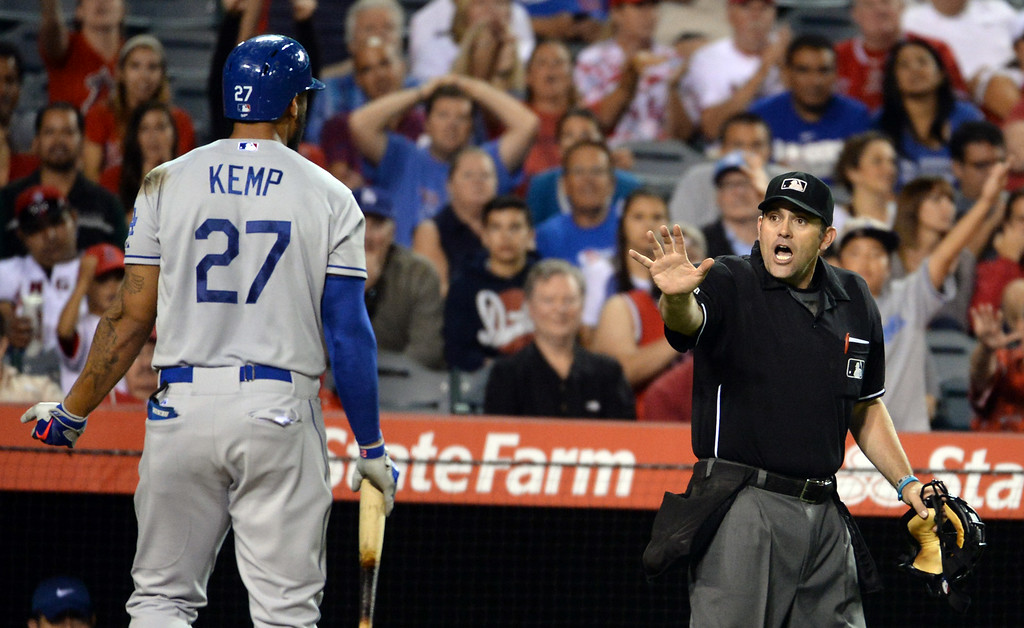 . Los Angeles Dodgers\' Matt Kemp (27) argues with home plate umpire Brian Knight and was ejected from the game in the eighth inning of a baseball game against the Los Angeles Angels at Anaheim Stadium in Anaheim, Calif., on Thursday, Aug. 7, 2014.  (Photo by Keith Birmingham/ Pasadena Star-News)