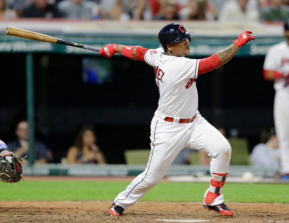 . Cleveland Indians\' Jose Ramirez watches an RBI double off Toronto Blue Jays relief pitcher Jeff Beliveau during the seventh inning of a baseball game, Friday, July 21, 2017, in Cleveland. (AP Photo/Tony Dejak)