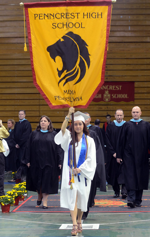 . Angela Anastasi holds the Penncrest High School flag during the opening procession during commencement at Villanova University, Thursday. (Times Staff / JULIA WILKINSON)