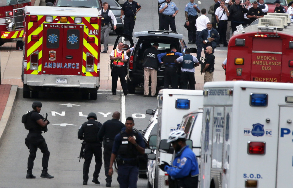 . Emergency vehicles and law enforcement personnel respond to a reported shooting at an entrance to the Washington Navy Yard September 16, 2013 in Washington, DC. According to the latest news report, several people were shot with the shooter still possibly active.   (Photo by Alex Wong/Getty Images)