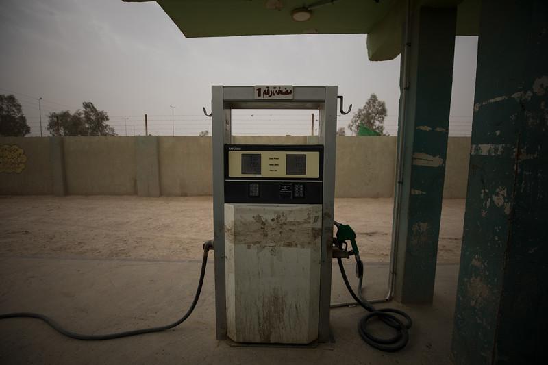 A pump at a service station dispensing petrol for $0.38 per litre ($1.44 per US gallon).